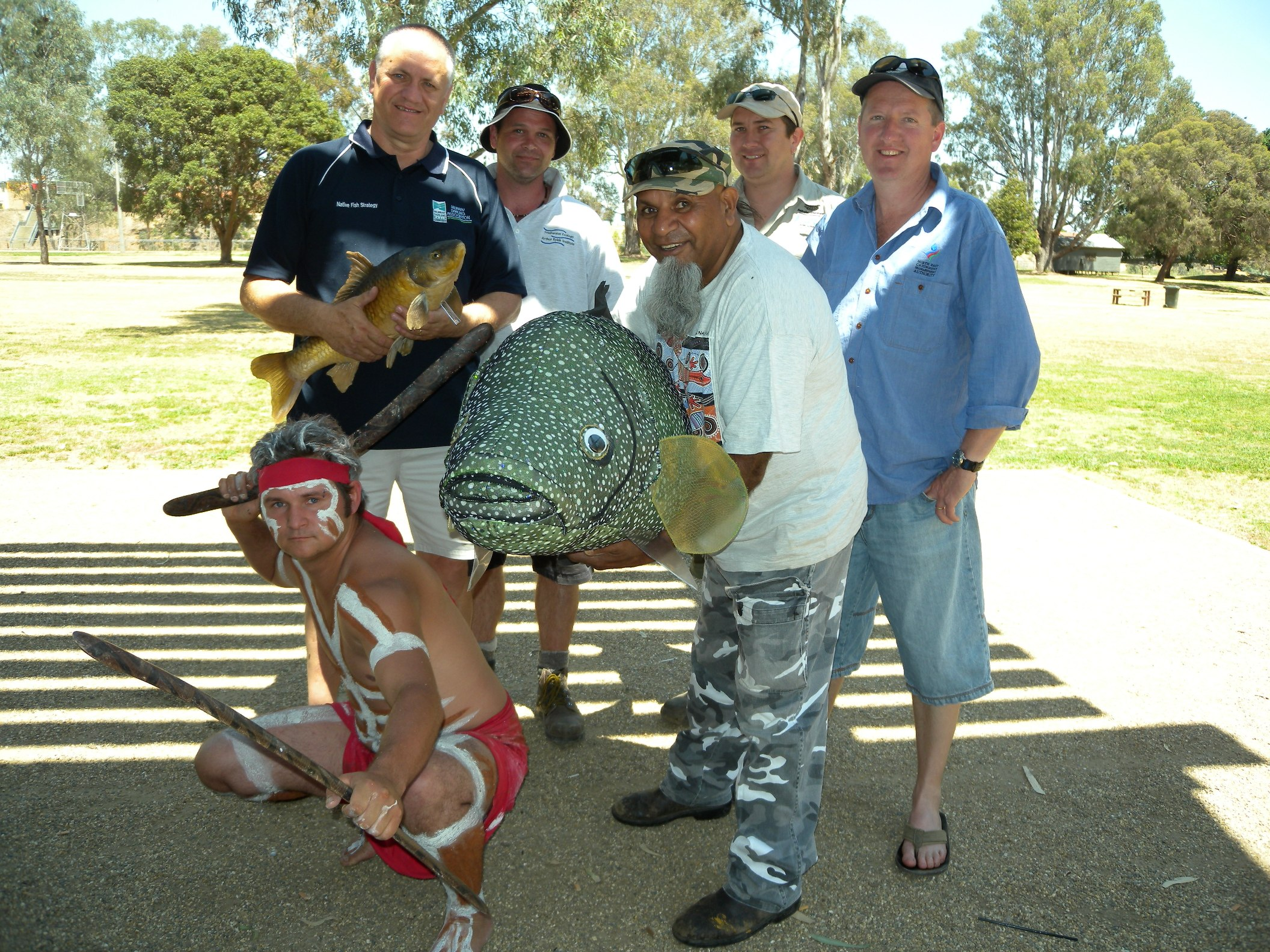Community members involved in an annual event to remove carp from the Ovens River